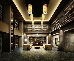 街と住まいの間で堪能する、贅沢なひととき。二層吹抜の大空間を優雅に飾るゲストハウスのようなエントランスホールは、この邸宅に住まうオーナーのために用意されたラグジュアリーな空間。