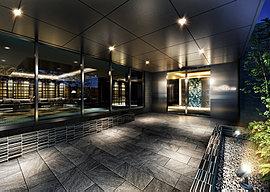 エントランスの動線には石を割ったときに表れるプリミティブな脈模様を取り入れた素材感のある床材を敷き詰め、風除室の壁には特徴的な曲線模様と美しいブルーの色彩で魅せるクロミウムブルーのタイルを採用。