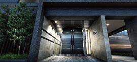 木質調のエントランス扉、ガラス、質感やトーンの異なる多彩なタイル。表情豊かなマテリアルが凛とした直線の中でひとつになり、シンプルな中にも確かな上質感を湛えたエントランスを構成する。