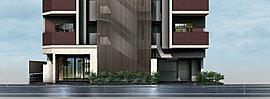 存在感あふれるアルミルーバーが印象的なファサード。基壇部となるエントランスの壁面には味わいのある石目調のタイルをあしらいました。奥に待つ木目調天井のエントランス空間と共に、上質な質感で訪れる人を迎えます。