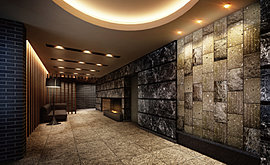 邸宅へ誘う迎賓の設え。タイルや石など素材へのこだわりと、暖炉の炎や間接照明など美しいコントラストを奏でる温もりに満ちた空間が、ここにしかない誇りと歓びをもたらす。