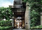 ドアを超えてなお高く広がるガラスウォールが、その内に秘めた二層吹抜のラグジュアリーな空間を予感させる。特別な空間への入口を自ら宣言する意匠が、明治通りを行く人の目に鮮やかな印象を残します。