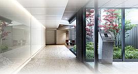 エントランスホールの壁面には鏡面素材を採用し、鮮やかな植栽の映りこみと広がりを感じる空間にしました。