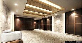 外観の格子のイメージを踏襲しながら、落ち着いた洗練の空間を提供するエントランスホール。