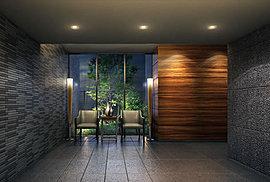 エントランスホールは壁面にライティングの効果で陰影のある質感を創り出しています。ラウンジスペースにラグジュアリーな家具を置き、後方にある自然の緑を取り入れた演出を施しています。