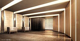 エントランスアプローチのオートドアを開け、館内に歩みを進めると、そこは日本の伝統美が息づくエントランスホール。緩やかな円弧を描く外壁には、縦ラインの深い陰影を創り出す突板パネルを採用。ホール奥には和紙調ガラスによる光壁を配色しています。