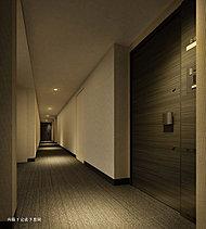 建物に足を踏み入れた瞬間から、深い安息に包まれます。それぞれの住戸へと導く共用廊下は、落ち着いた内廊下設計。雨や風にさらされることなく自室へ往来でき、また、外界からの視線を遮断し、不審者の侵入も防ぎます。