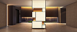 エントランスホールの象徴ともいえる光柱。和紙のようなテクスチャを採用することで、行灯のようにやわらかな光の演出を施しています。また江戸切子をモチーフとした文様や、江戸織物の幾何学模様を採用することによって洗練された伝統美を描き出しました。