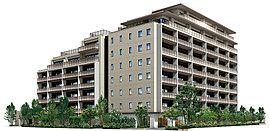 外壁には落ち着いた住宅地の街並みに調和するアースカラーのタイルを採用、1スパンのグリッドのマリオンを設置することで、建物全体のデザインを整えました。