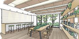 集いのシーンが描かれる、みんなのラウンジ。木目調のタイルがアットホームな空気を醸すシェアラウンジ。折上天井と間接照明を設けて、ゆとりある広さを持たせました。