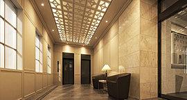エントランス全体の空間はアーリー・アメリカン調のクラシカルテイスト。外観同様、石調大板タイルを壁全体に採用し、ダーク系の床タイルで引き締め効果を演出。