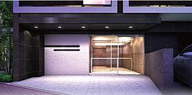 基壇部となるエントランス周りにはブラックとグレー基調の素材を施し、都市邸宅としての重厚感を演出。床と壁面、飾り壁には自然の風合いのある素材を施し、都心から帰り着く人を優しく出迎えます。
