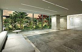 エントランスホールの壁面には大理石調のタイルを張り合わせ、空間全体の高級感を創出。私邸へと向かうひとときに、豊かな安らぎを添えている。