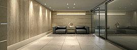 ルーバーが連なる風除室から趣を一変させ、静の空間として柔らかな印象を醸すラウンジ。御影石の床からIMOLA社製の大判タイルへ優しい色調に切り替わり私邸へと誘う。