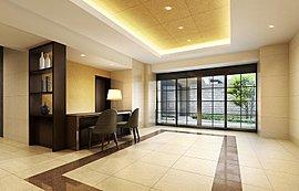 オーナーズガーデンに開かれた明るいエントランスホール。ライフサービスをご提供するコンシェルジュカウンターを設けています。
