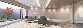 穏やかな暮らしを演出する、開放的なパークフロントの邸宅。オーナーズガーデンを眺める明るいエントランスホール。素材の質感を豊かに伝えるマテリアルを床・壁に用いて、格調高いデザインを施したエントランスホール。