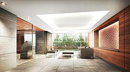 多くの人が行き交うエントランスホールは、天然石を基調とした落ち着きある空間に。一方で、西側正面にはモザイクタイルと木調パネルを組み合わせたアイストップを設けるなど、素材の違いによって空間に奥行きある表情を生み出しています。