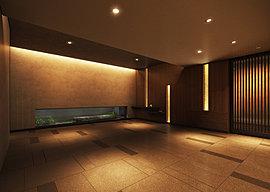 柔らかな照明による陰影効果でオーナーを魅了する「奥の間」と名付けたエントランスホール。坪庭をはじめ、壁、天井からなる照明計画で、凛とした美しさの中に落ち着きを与える空間に。エントランスホールに配した坪庭は石を主体とした「月の庭」をデザイン。