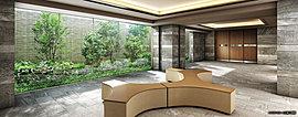 エントランスを抜けた先に広がるゆったりとしたホール。ゲストとの待ち合わせや歓談ができるソファを設けた迎賓空間です。ガラス越しに緑の潤いが息づき、洗練された素材が格式の高さを主張します。