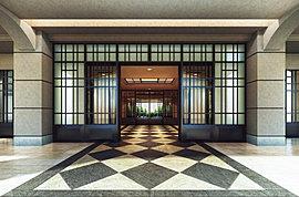 パリのラグジュアリーホテルをイメージしたグランドエントランスの扉の向こうにある、「エントランス・パサージュ」。石調の質感が異国の街中を思わせます。