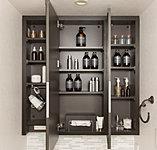 三面鏡裏に小物やドライヤー等を収納できるスペースを確保。化粧品などもすっきりと収納できます。