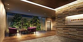 住まいへと帰るオーナーを優しく迎えるエントランスホール。床には、豊かな風合いの石調タイルを、壁には天然石を使用し、ここにしかない落ち着きに満ちた空間を創り上げています。