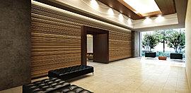 プロムナードの潤いと賑わいに招かれるようにエントランスを入る。そこに待つのは、マテリアルの贅沢な質感とモダンなデザインに彩られたホール。