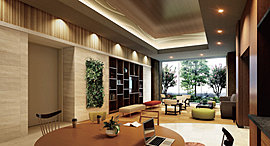 ホールから、奥に進むと空間はさらに親密さを増していく。ホールとは別室のようにしつらえられたコミュニティールーム。心地よいソファやチェア、テーブル、ブックシェルフを配した落ち着きある空間です。