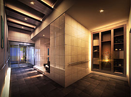 照明や絵画、オブジェが飾られた棚など、緻密な意匠を施したエントランスホール。お洒落なホテルのロビーのように、高い美意識と上質感に満たされた共用スペースです。