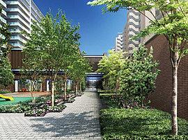 「エスコートグリーン」は、敷地西側のゲートへと続く動線を緑で演出した小径。近接する座王公園の緑とつながりを持たせながら、自転車置場や各住棟へとアプローチ。徒歩1分の小学校への登下校などの場面にやすらぎをもたらします。