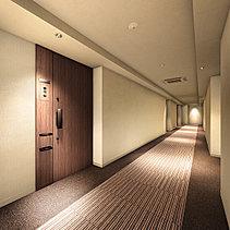 私邸へと誘うインナーコリドー。私邸へと続く共用廊下は、外界からの視線を遮るインナーコリドー(内廊下)。1階部分は、天井面にファブリックを用いた柔らかな照明計画や、床や片側壁に木目調タイルを使うなど、落ち着いた空間意匠としました。