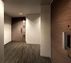 静謐さとプライバシー性に配慮したホテルライクな内廊下設計。私邸へのアプローチには、内廊下を採用。 風格が漂う設えを施している。
