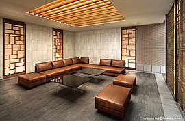 真タイル貼りの壁に照明に浮かびあがる木のアクセントウォールをデザインし、エントランスホールと程よく仕切られた落ち着いたウェルカムホール。大型のソファーを配してゆったりとした時を楽しむ大人の空間。