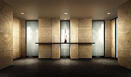 風除室からエントランスホールへのシンメトリーデザインを引き立てるように、壁面には大判の天然石を張り巡らせて、堂々とした表情を演出。ホール正面には照明を受けて煌めくアートを設え、その先に広がる洗練の邸宅時間へと誘います。