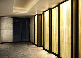 デザインウォールや天井の間接照明が、空間を美しく彩るエントランスホール。その先に待つのは、ホテルライクな内廊下。この邸宅は、プライベートへのアプローチにも「質」を宿しています。