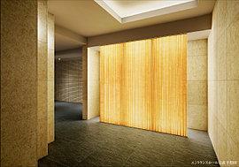 住まいの「顔」としてのこだわりを。エントランスホールの装飾には、やさしい光を放つ光壁を設置。住まう人、訪れる人、全ての人をあたたかく包み込む空間としました。