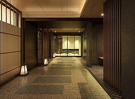 茶室の趣、ゆかしく。京の美が息づくエントランスホール。通りからの視線を遮りながら、まるで京の裏路地を歩くような「奥」の深さを感じさせるL字型のアプローチ。