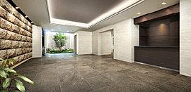 全面ガラス張りのドアから入るエントランスホールは、奥に坪庭風の植込を望む伸びやかな空間。重厚感ある素材で仕上げた床や壁、間接照明付の折上天井などが格調高い雰囲気を醸し出し、確かな高級感を創出します。