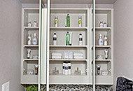 ボトルソープなどをスッキリと収納できるスペースを洗面化粧台のミラー裏側にご用意しました。