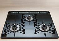 お手入れ簡単で丈夫なガラストップの天板。温度調節や消し忘れ防止など、多彩な機能を装備しています。