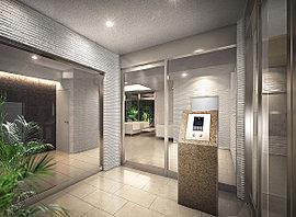 風除室からエントランスホールにかけては質感豊かなタイルを用い、優雅な迎賓空間を演出。シンプルなカラーで統一することで、洗練された外観デザインを踏襲しました。