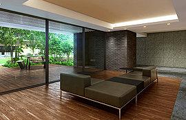 中庭の四季を映す窓ガラスの傍には、ソファやテーブルを配し、親しい方と語り合ったり、あるいはお出かけの待ち合わせをするなど、人と人の触れ合いを育む空間デザインにこだわりました。またラウンジから中庭へ延びるデッキが外の緑とのつながりを創出します