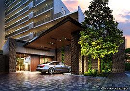 上部に庇を設け、雨の日でも濡れずに車の乗り降りができる「車寄せ」。スリット状に壁面緑化※を内部まで連続させたデザインで、外から内へと豊かな自然に導かれる動線をつくりだしています。※一部人口壁面緑化