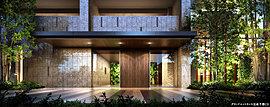 豊かな緑を感じながら、やすらぎの住まいへ。御影石の外壁と木調の扉のコントラストが、住まう人やゲストを格調高く、そして柔らかな表情で迎え入れます。