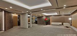 スクエアに広がる開放感と気品あふれる端正な空間美が、上質な寛ぎを創りだすエントランスホール。