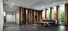 ウッドの列柱の間に窓ガラスとブラックウォールを配した気品溢れるエントランスホール。