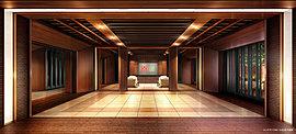 重厚感のある壁や床に射し込む繊細な光によって薫り立つ品位が、空間を美しく紡ぐエントランスホール。都心の喧騒から隔絶された静謐さは、気品をもってゲストを迎えられる気高かさに満たされている。