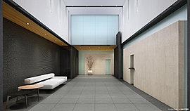 エントランスホールは、歓待の場にふさわしい2層吹抜の贅沢な空間を設計。高く伸びやかな空間は、明るく瀟洒な印象を与え、住まう方や大切なゲストを優雅にお迎えします。