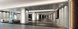 エントランスホールに配置された光壁が、光と影を巧みに演出した気品ある空間を創出。