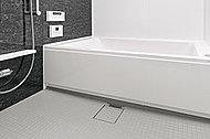 浴槽へのまたぎ高を約450㎜に抑え、出入口の段差も極力解消した、低床設計のユニットバスを採用しました。さらに、壁には手すりを設置。浴槽のふちが広いので入浴時に腰掛けて入れます。